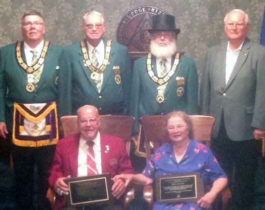 (Back: L-R)Grand Treasurer-Secretary Denny Robinson, PGM; Deputy Grand Master Don Gray; Grand Master Doug McFarland; and Past Grand Master Virgil Andersen honor Past Grand Master Les and Bettie Spies